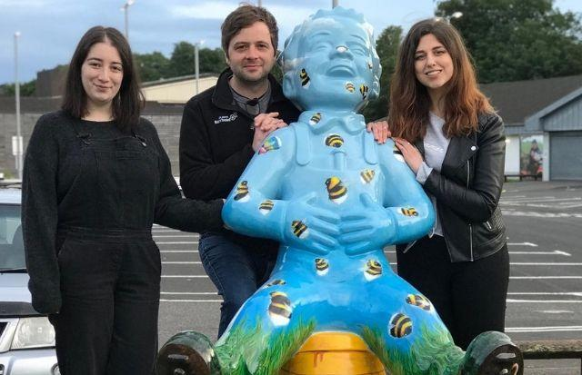 BID project management assistant, Colette Edenborough, BID manager Andy Dunlop, and Bronwyn Gilgallon, artist of the Buzzin' sculpture