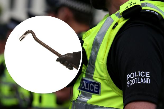 Man arrested for allegedly brandishing crowbar in busy street