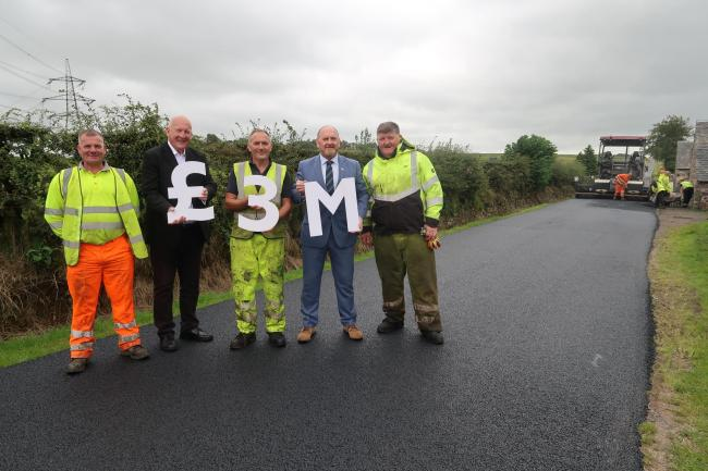 Council leader Tony Buchanan (second right) and environment convener Councillor Alan Lafferty (second left) joined workers at Sergeantlaw Road, in Barrhead, to announce the extra investment