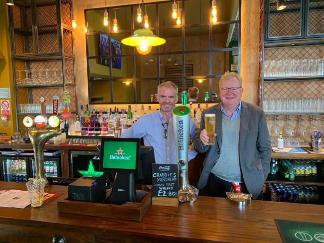 Jackson Carlaw MSP pictured trying out his pint making skills with licensee, Andy Crossan when visiting on Friday October 11.
