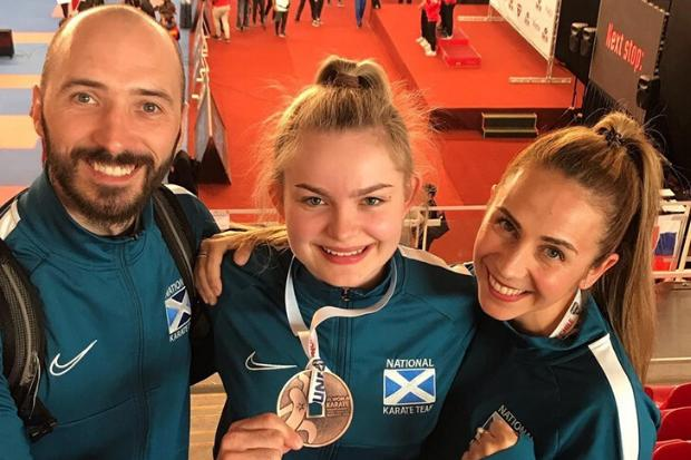 Niamh, centre, with her WKF U21 World Championships bronze medal