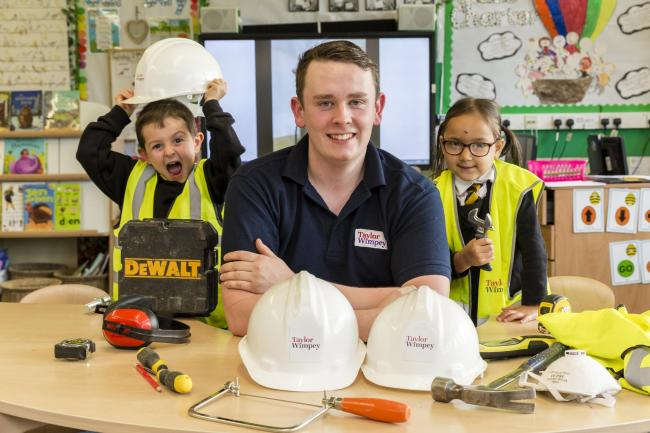 Primary one pupils get hands on with joiner Fraser Martin