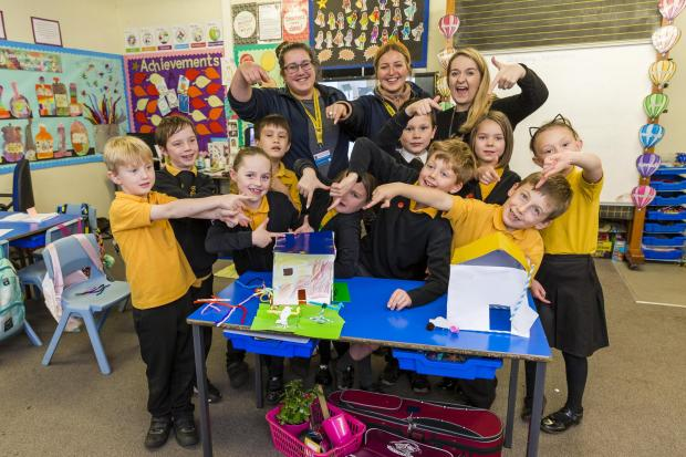 Barrhead News: Children at Neilston Primary enjoyed building model homes with Errin Hendry-Giles and Naomi Sturdy, of Taylor Wimpey