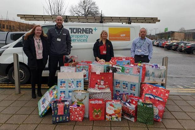 Staff from Barrhead Housing Association and Turner Property Services donated a pile of presents