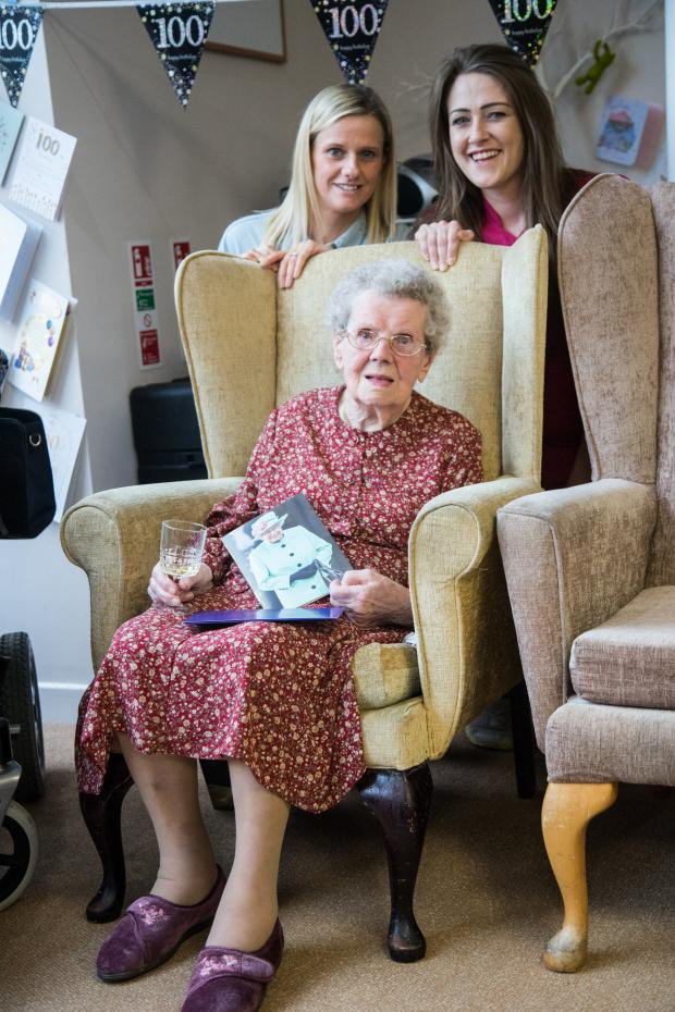 Barrhead News: Jenny Scott celebrates her special day with Parkhouse Manor staff Leanne Taggart (left) and Brooke Curran