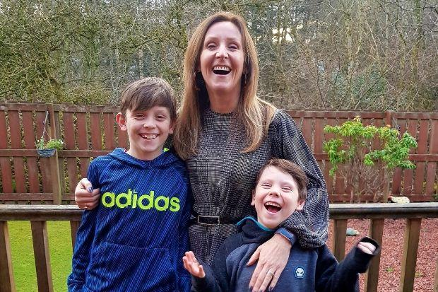 Businesswoman Laura Molloy with her sons James and Charlie
