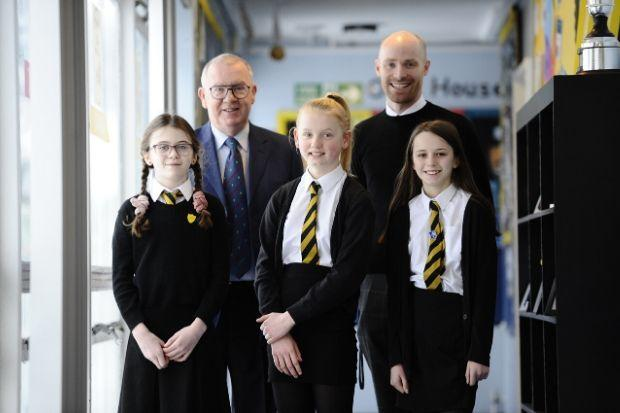 Master of the Lodge John Miller (back row, left) and principal teacher Andrew Howie with Neilston Primary pupils Chloe, Ellie and Heather