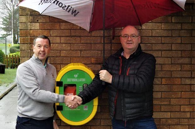 Chris Hughes and Bert Holt with the golf club's new defibrillator