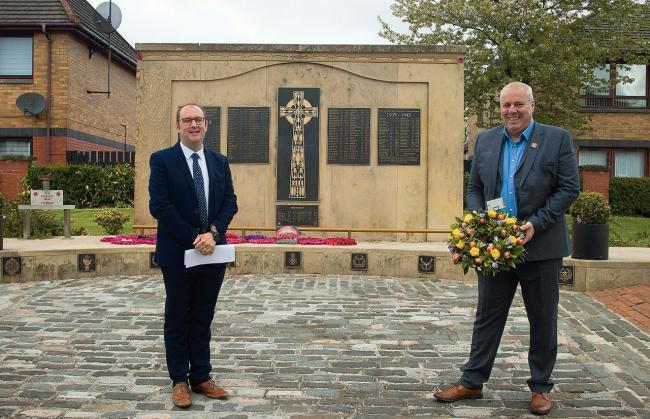 Councillor Paul O'Kane (left) and Matt Drennan at Neilston's war memorial