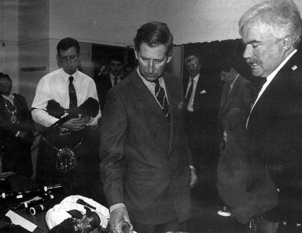 Barrhead News: Iain and Dougie with Prince Charles at the opening of the National Piping Centre in 1998 - Photos: Bagpipe.News/TNPC