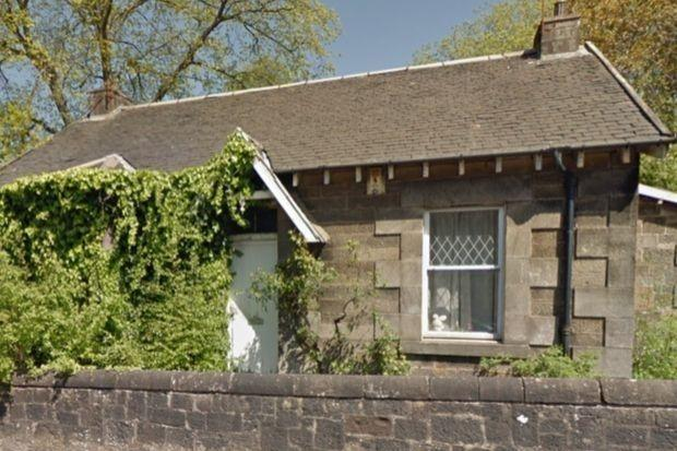 Plans to replace the former station master's house in Clarkston with four shops have been rejected by East Renfrewshire Council.