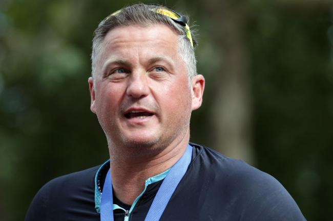 Darren Gough looks on