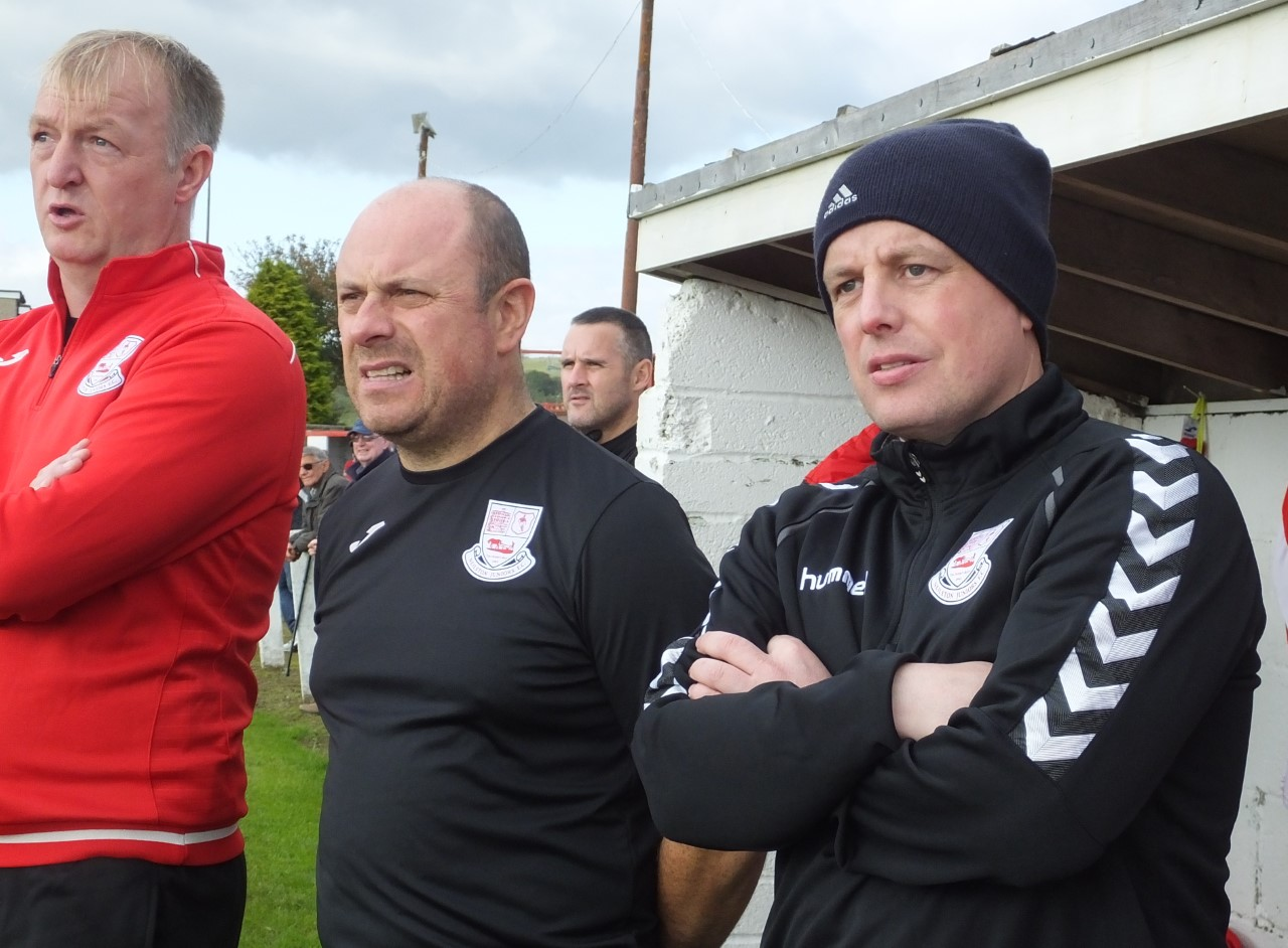 Martin Campbell (centre) says Neilston will be better prepared next season