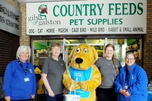 Staff at Country Feeds donated money to the Guide Dogs Scotland charity