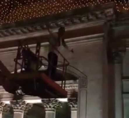 Man climbs onto cherry picker at Royal exchange square and starts crowd singalong in front of police
