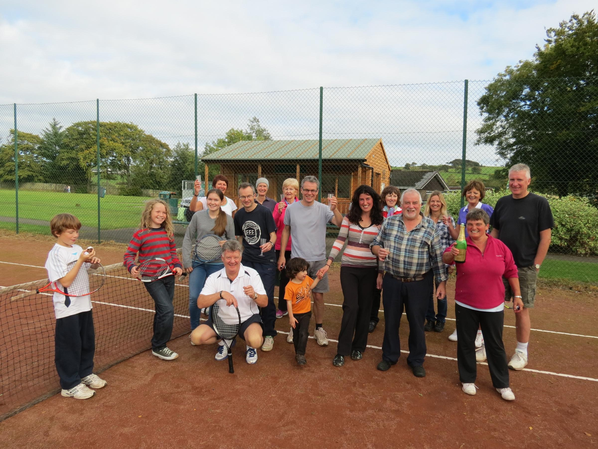 Uplawmoor Tennis Club members bid a fond farewell to their old blues courts, which were replaced with all-weather surfaces three years ago, a move that set the club on the road to league success.