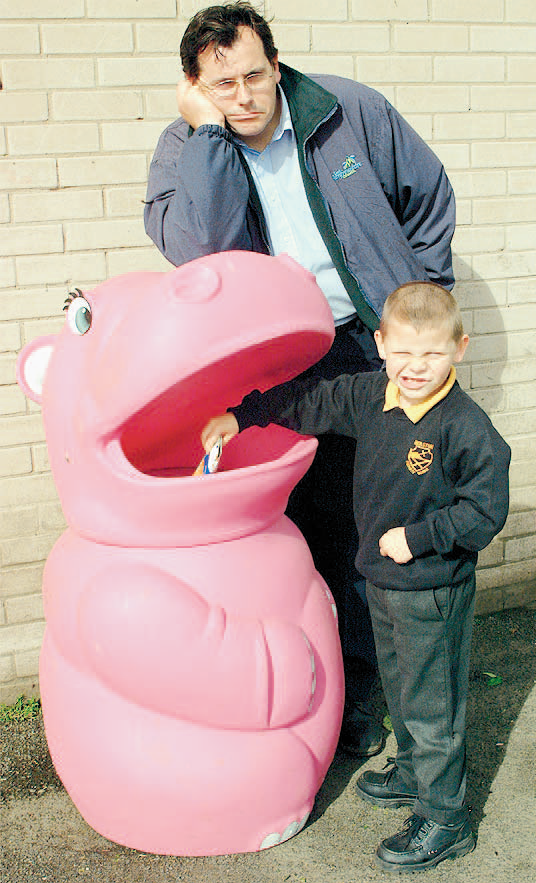 Schoolkids in the pink as hippo made happy return