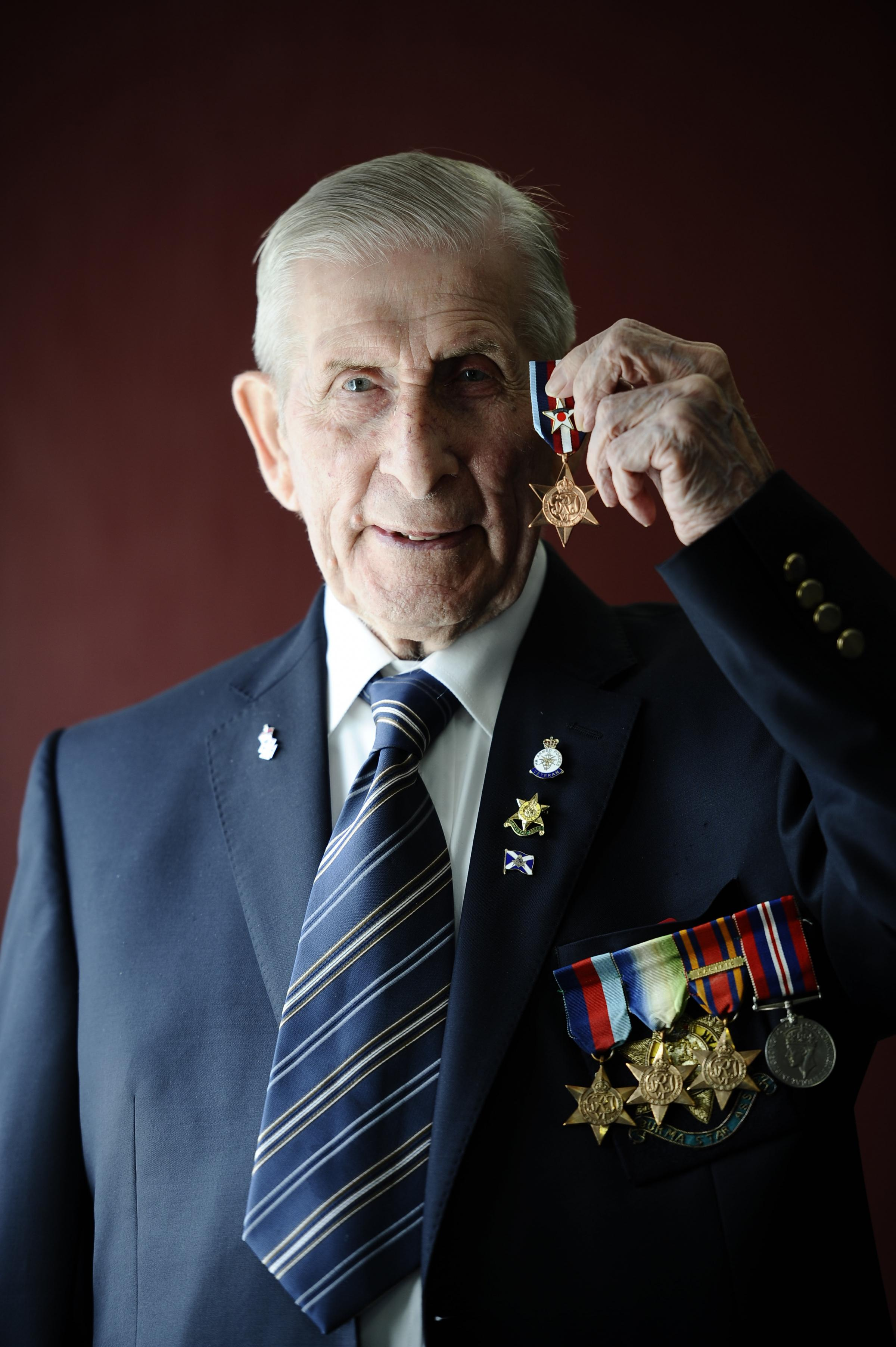 Edwin Leadbetter with the Arctic Star medal he was awarded for his service on the perilous convoys