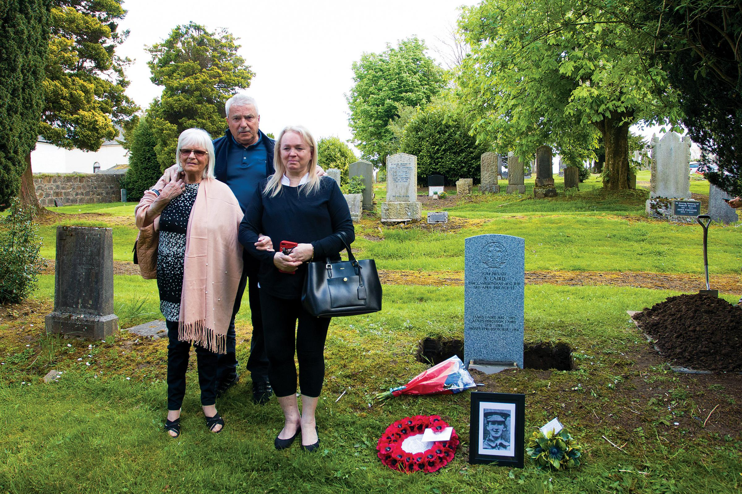 Family members Elizabeth Laird Limevall, John Laird and Jean Laird Avery at the new headstone