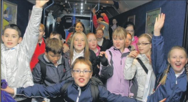 Archive: Kids hopped aboard 'Wee G' bus