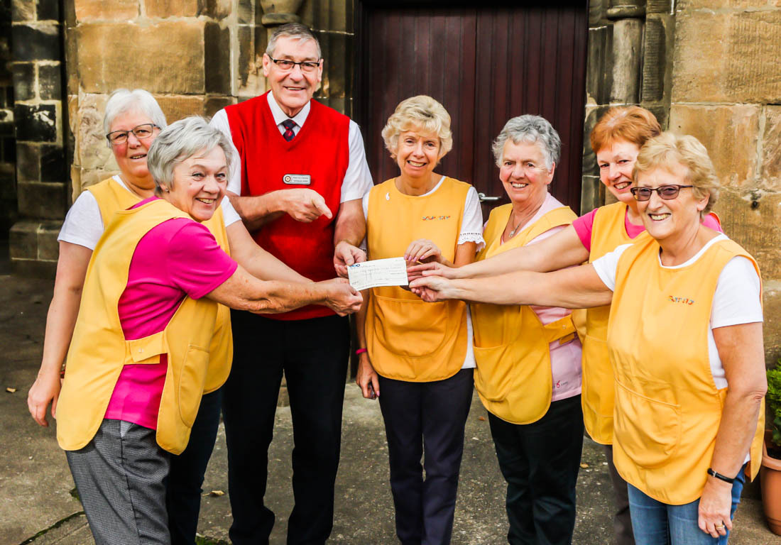 Photo taken outside Bourock Parish Church and shows Douglas Yates being presented with the cheque by some of the 'Soup Stop' volunteers.  Photo courtesy of Bob Flynn.