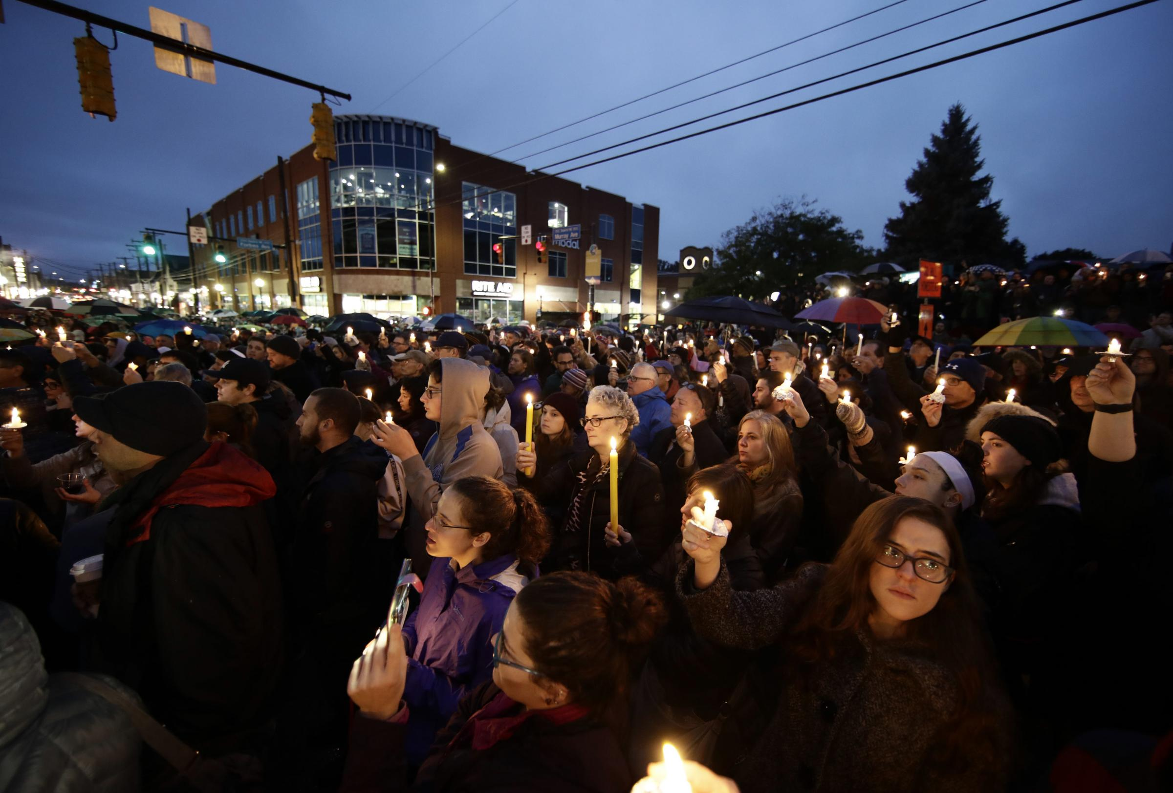 A crowd gathered to light candles in memory of victims of the Pittsburgh shooting