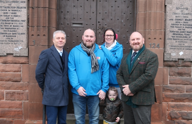 Paul and Ashley McIlvenney, joined by their son Casper, are pictured with Phil Daws, head of environment for East Renfrewshire Council, and council leader Tony Buchanan (right)