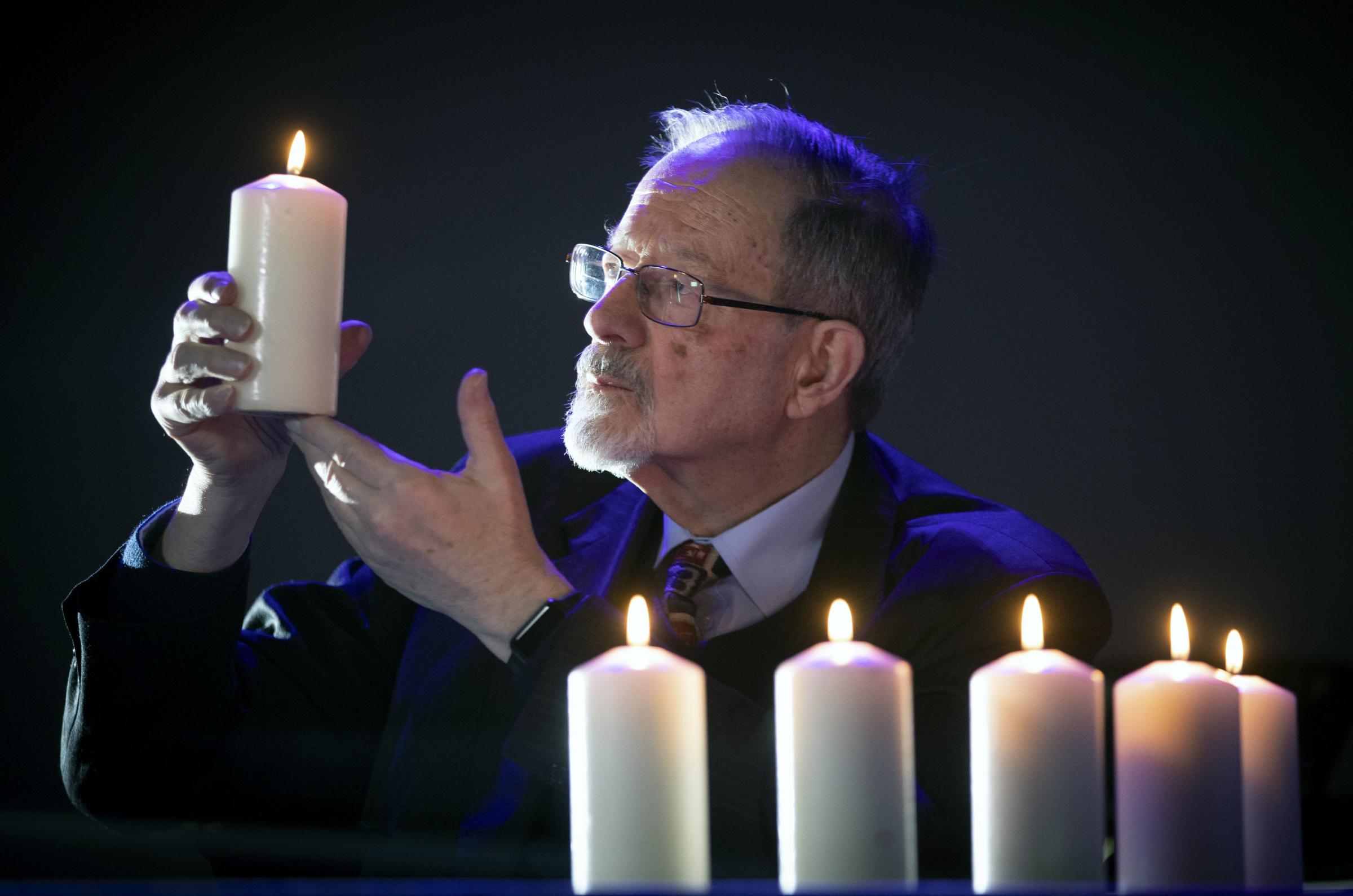 Holocaust survivor, Martin Stern, lights the candles to mark Holocaust Memorial Day