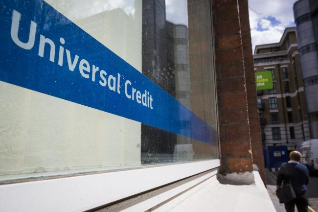 LONDON, ENGLAND - MAY 03: A Universal Credit sign in the window of the Job Centre in Westminster on May 3, 2016 in London, England. The Resolution Foundation, chaired by former Conservative Minister David Willets, has said the Government's benefit