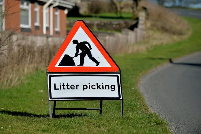 Campaign group tackle litter to keep their village clean
