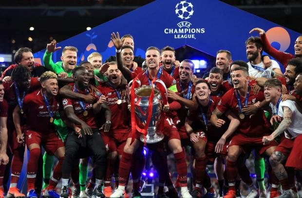 Barrhead News: Andy Robertson joins his team-mates as captain Jordan Henderson lifts the Champions League trophy
